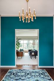 turquoise wall paint with brass entry contemporary and