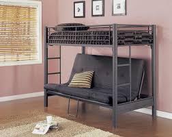 black iron ikea loft bed with black vinyl couch on wooden floor