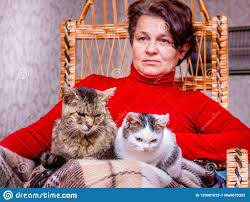 A Woman Sits In A Rocking Chair And Holds Two Cats In Her ... Is Your Chair Killing You The Consequences Of Comfort Rocking By Gae Aulenti For Poltronova 1962 Best Chairs Parenting How To Choose The Cushion Set 6 Zero Gravity Complete Guide Buying A Polywood Blog 10 Camping 20 Clevhiker Wikipedia Gaming Chairs Pc Gamer Senior Woman Texting With Smart Phone In Rocking Chair D985_68_163 Best Ipdent