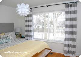 horizontal striped curtains with king sized and wooden floor