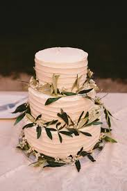 Frosted Wedding Cake With Greenery Garland