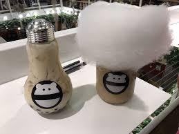 milk tea with boba light sweet in lightbulb on left