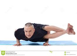 Smiling Flexible Man Posing In Difficult Yoga Pose