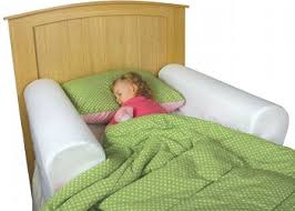 a baby or toddler bed rail is very helpful to transition from crib