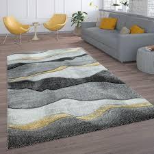 wohnzimmer teppich wellen look grau gold