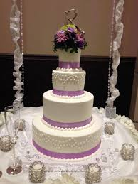 Wedding Cake Toppers 021 Four tiered white wedding cake decorated with purple ribbon and flower topper with purple