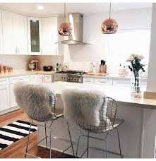 White Kitchen With Copper Accessories