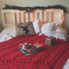 An Evergreen Garland With Lights On The Headboard Will Turn Your Bedroom Into A Holiday Spot