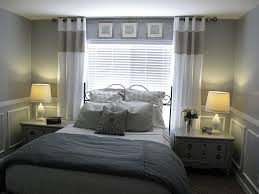 Bed In Front Of Window With Bedside Tables On Each Side I