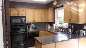 White Cabinets Dark Gray Countertops by Light Oak Cabinets Honey Oak Kitchen Cabinets With Black