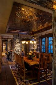 faux tin ceiling tiles dining room rustic with area rug big sky