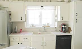 lighting stunning light above kitchen sink related to interior