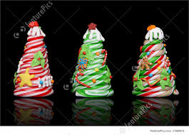 Holidays Three Colorful Candy Cane Christmas Trees Over Black Background