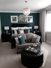 Bedroom With A Beautiful Green Or Teal Feature Accent Wall And Black Accents