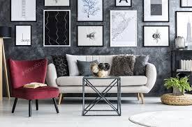 roter sessel in der nähe beige sofa im modernen wohnzimmer interieur mit foto bialasiewicz auf envato elements