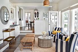 wicker ottoman in living room beach style with beadboard walls