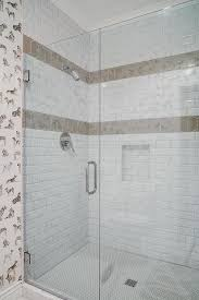 white shower tiles with taupe border accent tiles transitional