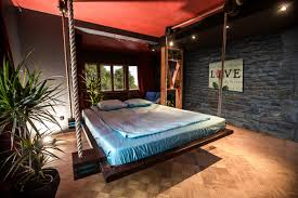 BedroomFuturistic Hanging Beds For Bedrooms Design With Dark Grey Stone Wall And Wooden Pattern