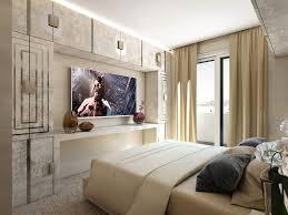 wohnzimmer mit klappbarem fernseher schiebeschrank mit tv