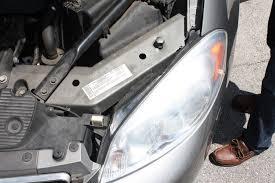 change the headlight bulb on a chevrolet impala