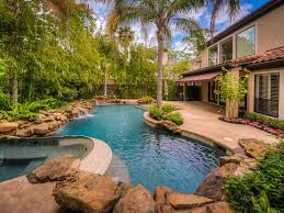 Gorgeous Backyard Oasis Has Zero-edge Pool, Spa And Summer Kitchen ... Proland Landscape Design Concept Small Backyard Backyard Oasis Pools Custom Pool Faux Rock Grotto 40 Slide 10 Ways To Create A Coastal Living Idea Use Multiple Levels To Define Different Photo Oasis Abreudme Around Images On Pinterest Gorgeous Has Zeroedge Pool Spa And Summer Kitchen Shapely Home Magazine N Designers Oriented Backyards Innovative By Fun Time And Yard Adorable 20 Designs Decorating Of Total 16 Inspirational As Seen From Above