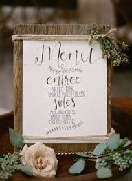 Hand Lettered Rustic Menu With All The Sweet Flowers It Deserves Cedarwoodweddings Charming Cottage Wedding