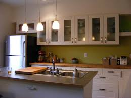 fabulous white kitchen cabinetry system with modern kitchen island