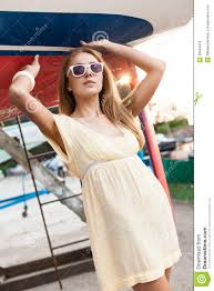 beautiful in summer dress at sea pier royalty free stock