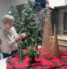 Anne Marie Amacher Carol Harrison Of The Catholic Service Board Prices A Decorative Christmas Tree In