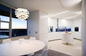 Modern Centerpieces For Dining Room Table by Minimalist Dining Room With Sculptural Pendant Lamp And Round