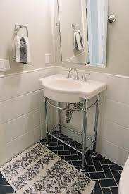 white washstand with black herringbone floor tiles contemporary