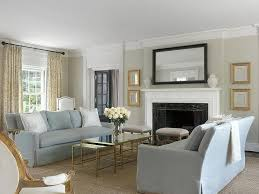 Gray Sofas With Brass And Mirror Nesting Coffee Tables