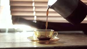 Coffee Being Poured Into Cup By Window
