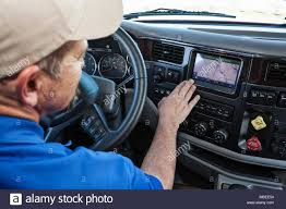 Driver Parked By The Side Of The Road Using A GPS Mapping Device In ... One20 Professional Truck Driver Gps Navigation System For Commercial Best Unbiased Reviews Elds And Privacy Will Quirement To Track Truckers Derail Dot Mandate 2018 Youtube 5 Core Benefits Of Drivers Gps Apps Technology Nyc Trucks Vehicles Navigation Device Wikipedia Systems Rand Mcnally Tnd530 With Lifetime Maps Wifi