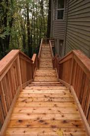 custom square cedar deck with traditional cedar railing in