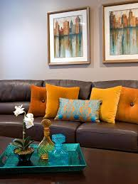 Brown Furniture Living Room Ideas by A Brown Leather Sofa Matches A Dark Wooden Coffee Table In Front