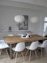 white plastic chairs light wooden table white chandelier