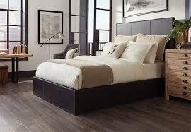 Dark Planks Of Wood Look Vinyl Flooring In A Master Bedroom