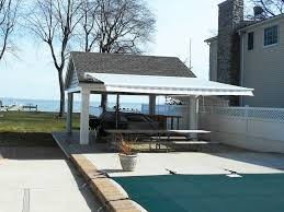 Retractable Awnings   A. Hoffman Awning Co Roof Screened Porch Designs Patio How To Build A Carports Metal Car Covers Prices Buy Carport Mounted Retractable Awning Residential Northwest Malaysia Superior Resistance 100 Over Deck Interior Freestanding Louvered Awnings Custom Retractable Roof System Intsalled By Melbourne Glass Roofs Express To Draw Corrugated On A Curved Youtube Pergola Windows Valance S Valances Pinterest Awesome Ed Home Ideas