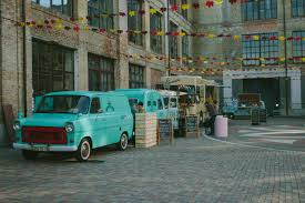 100 Green Food Truck Minivan Near Brown Wooden Crate And Brown