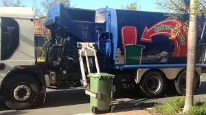 EDITORIAL - Garbage Truck Arrives To Pick Up A Wheelie Bin. Stock ...