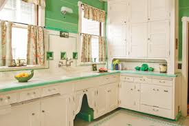Retro 1920s Kitchen Design With White Cabinets And Green Wall