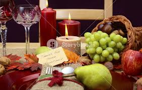 Country Style Rustic Thanksgiving Table Place Setting Closeup With Chair Cornucopia Wine Glasses Fruit Nuts And Burning Candles
