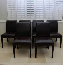 crate barrel brown leather pullman dining chairs ebth