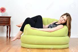 Full Image For Bean Bag Turns Into Bed Stock Photo Teen Relaxing In Green