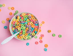 Froot Loops Cereal In A Bowl On Pink Background