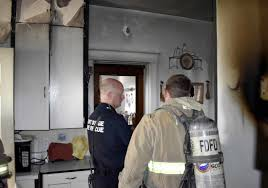 Messenger Photo By Chad Thompson Lt Tom Ubben Of The Fort Dodge Fire Department Looks Over A Damaged Stove At 1010 S 15th St Tuesday Afternoon