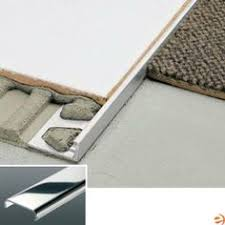 Wood To Tile Metal Transition Strips by Metal Transition Strip Between Hardwood Flooring And Tile How To