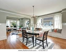 Medium Gray Walls View Of A Classic Dining Room With And Tone Hardwood Floors Dark Curtains For
