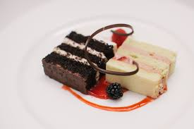 Slices of chocolate cake with chocolate mousse filling vanilla cake with cream strawberry filling